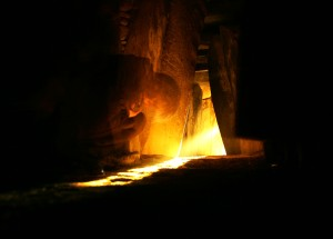 The woman here is bathed in sunlight from the Winter Solstice at Newgrange