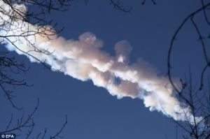 The blinding glare subsided as the smoke trail broke into two