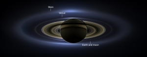 A real color image taken of Saturn, with Earth, Mars, Venus and a few moons visible