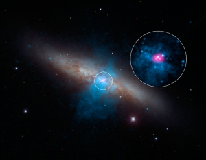 High-energy X-rays streaming from a rare and mighty pulsar (magenta), the brightest found to date, can be seen in this new image combining multi-wavelength data from three telescopes. The bulk of a galaxy called Messier 82 (M82), or the
