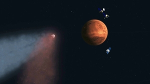 Artist's concept of Comet Siding Spring approaching Mars, shown with NASA's orbiters preparing to make science observations of this unique encounter. Image Credit: NASA/JPL