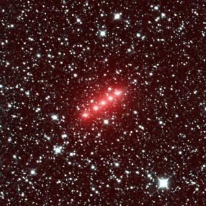 Comet C/2014 Q2 (Lovejoy) is one of more than 32 comets imaged by NASA's NEOWISE mission from December 2013 to December 2014. This image of comet Lovejoy combines a series of observations made in November 2013, when comet Lovejoy was 1.7 astronomical units from the sun. (An astronomical unit is the distance between Earth and the sun.)  The image spans half of one degree. It shows the comet moving in a mostly west and slightly south direction. (North is 26 degrees to the right of up in the image, and west is 26 degrees downward from directly right.) The red color is caused by the strong signal in the NEOWISE 4.6-micron wavelength detector, owing to a combination of gas and dust in the comet's coma.