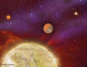 This artist's conception shows the 30 Ari system, which includes four stars and a planet. The planet, a gas giant, orbits its primary star (yellow) in about a year's time. The primary star, called 30 Ari B, has a companion -- the small