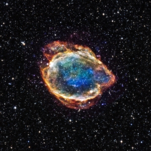 G299 was left over by a particular class of supernovas called Type Ia. Astronomers think that a Type Ia supernova is a thermonuclear explosion – involving the fusion of elements and release of vast amounts of energy − of a white dwarf star in a tight orbit with a companion star. If the white dwarf's partner is a typical, Sun-like star, the white dwarf can become unstable and explode as it draws material from its companion. Alternatively, the white dwarf is in orbit with another white dwarf, the two may merge and can trigger an explosion.