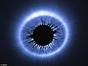 Captured by the Hubble Space Telescope, this image shows the huge dusty debris discs around a star called HD 181327, showing a huge spray of debris possibly caused by the recent collision of two bodies into the outer part of the system. Read more: http://www.dailymail.co.uk/sciencetech/article-2826048/Hubble-spots-massive-eye-sky-reveal-massive-dust-clouds-left-planets-form-say-moon-formed.html#ixzz3gjPl6sI1 Follow us: @MailOnline on Twitter | DailyMail on Facebook