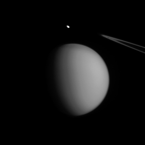 In this Cassini image taken on July 2, 2015 little moon Pandora appears to hover behind bigger brother Titan, but is actually almost three times closer at 436,000 miles (698,000 kilometers). Image credit: NASA/JPL-Caltech/Space Science Institute