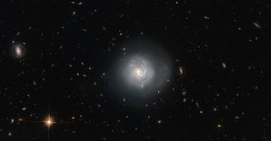 Sprinkled throughout this stunning image are numerous examples of almost every type of galaxy on the Hubble Tuning Fork. Almost all of the light smears and specks viewed are distant galaxies astronomers study in order to delve deeper into the mysteries of the evolution of these islands of stars.