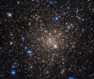 Old, red stars inhabit globular cluster Terzan 1, which is a few hundred light-years across. The brighter, blue stars in this image are in fact foreground stars, and not part of the globular cluster. Image credit: NASA & ESA