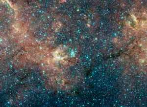 This color composite image compiled by the Spitzer Space Telescope highlights the colors of the cosmos. Credit: NASA/ESA/STScI