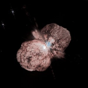 The massive star Eta Carinae (almost hidden in the center) underwent a giant explosion some 150 years ago. The outburst spread the material that is visible today in this very sharp Hubble image. Even though Eta Carinae is more than 8,000 light-years away, structures only 15 thousand million kilometre across (about the diameter of our solar system) can be distinguished. Dust lanes, tiny condensations, and strange radial streaks al appear with unprecedented clarity. A huge, billowing pair of gas and dust clouds are captured in this stunning Hubble Space Telescope image of the supermassive star Eta Carinae. Credit: Jon Morse (University of Colorado), and NASA/ESA