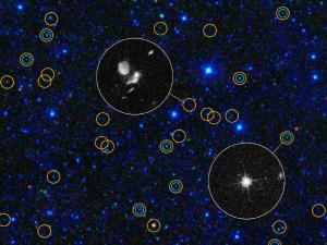 This zoomed-in view of a portion of the all-sky survey from NASA's Wide-field Infrared Survey Explorer shows a collection of quasar candidates. Quasars are supermassive black holes feeding off gas and dust. The larger yellow circles show WISE quasar candidates; the smaller blue-green circles show quasars found in the previous visible-light Sloan Digital Sky Survey. WISE finds three times as many quasar candidates with a comparable brightness. Thanks to WISE's infrared vision, it picks up previously known bright quasars as well as large numbers of hidden, dusty quasars. The circular inset images, obtained with NASA's Hubble Space Telescope, show how the new WISE quasars differ from the quasars identified in visible light. Quasars selected in visible light look like stars, as shown in the lower right inset; the cross is a diffraction pattern caused by the bright point source of light. Quasars found by WISE often have more complex appearances, as seen in the Hubble inset near the center. This is because the quasars found by WISE are often obscured or hidden by dust, which blocks their visible light and allows the fainter host galaxy surrounding the black hole to be seen. Image credit: NASA/JPL-Caltech/UCLA/STScI