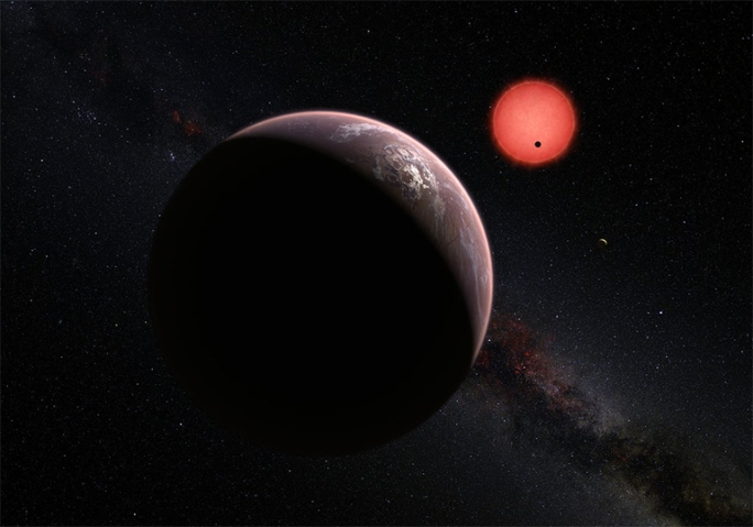 This artist's impression shows an imagined view of the three planets orbiting an ultracool dwarf star just 40 light-years from Earth that were discovered using the TRAPPIST telescope at ESO's La Silla Observatory. These worlds have sizes and temperatures similar to those of Venus and Earth and may be the best targets found so far for the search for life outside the Solar System. They are the first planets ever discovered around such a tiny and dim star. In this view one of the inner planets is seen in transit across the disc of its tiny and dim parent star.