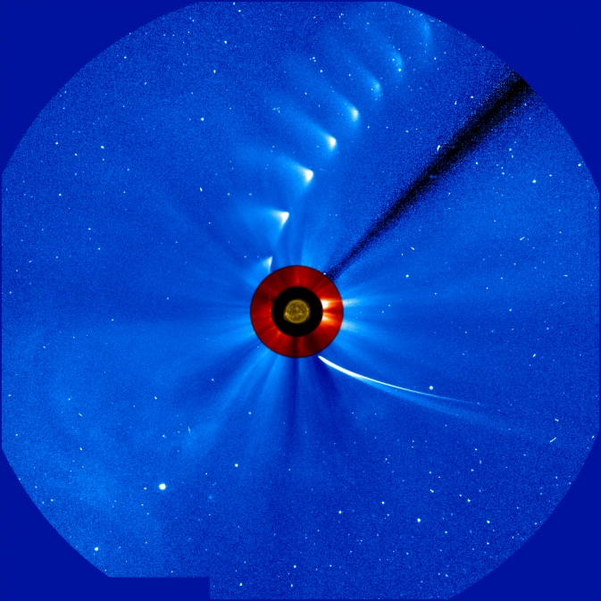 Comet ISON comes in from the bottom right and moves out toward the upper right, getting fainter and fainter, in this time-lapse image from the ESA/NASA Solar and Heliospheric Observatory. The image of the sun at the center is from NASA's Solar Dynamics Observatory. Image Credit: ESA/NASA/SOHO/SDO/GSFC