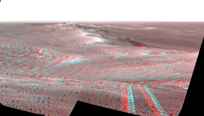 This stereo scene recorded by the Pancam on NASA's Mars Exploration Rover Opportunity on Aug. 15, 2014, looks back toward part of the west rim of Endeavour Crater marked with the rover's wheel tracks. It appears three-dimensional when seen through blue-red glasses with the red lens on the left. Credits: NASA/ESA