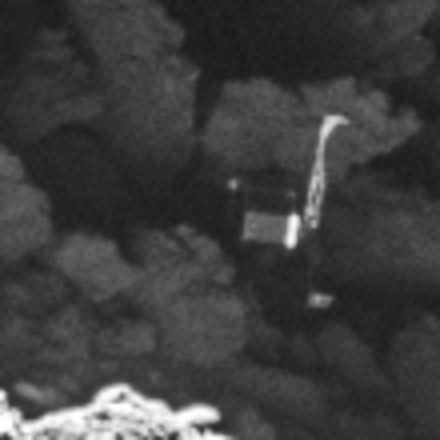 Close-up of the Philae lander, imaged by Rosetta's OSIRIS narrow-angle camera on 2 September 2016 from a distance of 2.7 km. The image scale is about 5 cm/pixel. Philae's 1 m-wide body and two of its three legs can be seen extended from the body. The images also provide proof of Philae's orientation. The image is a zoom from a wider-scene, and has been interpolated. More information: Philae found! Credit: ESA/Rosetta/MPS for OSIRIS Team MPS/UPD/LAM/IAA/SSO/INTA/UPM/DASP/IDA