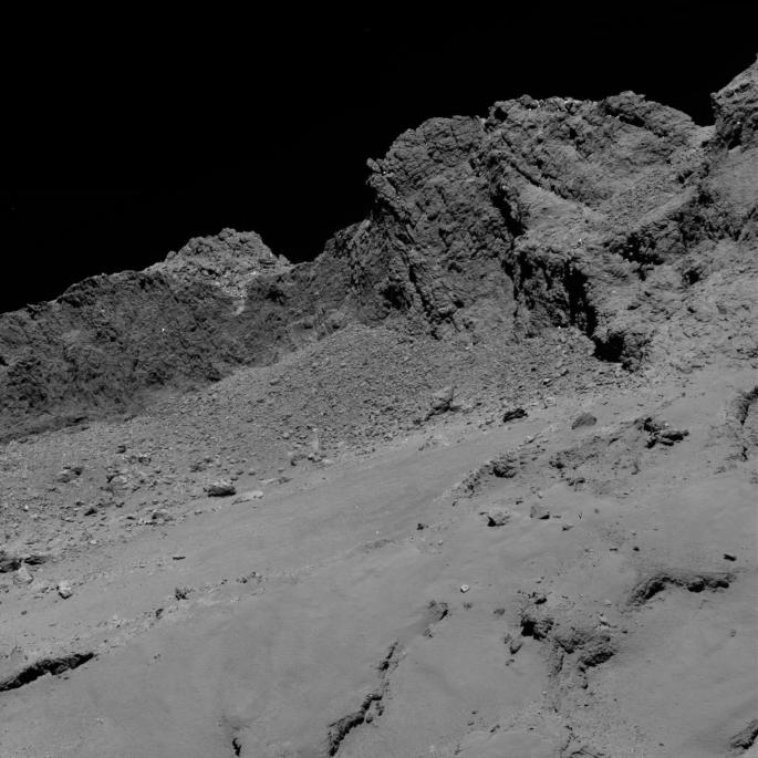 The OSIRIS narrow-angle camera aboard the Space Agency's Rosetta spacecraft captured this image of comet 67P/Churyumov-Gerasimenko on September 30, 2016, from an altitude of about 10 miles (16 kilometers) above the surface during the spacecraft's controlled descent. The image scale is about 12 inches (30 centimeters) per pixel and the image itself measures about 2,000 feet (614 meters) across. Credits: ESA/Rosetta/MPS/UPD/LAM/IAA/SSO/INTA/UPM/DASP/IDA