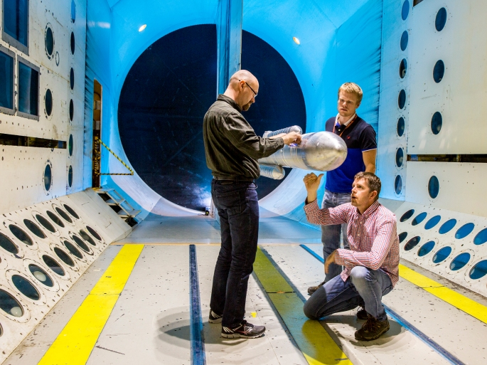 Space Launching System installed in the Transonic Dynamic Tunnel for testing. Engineers, Martin Sekula, Mike Ramsey and David Piatak surveys the model before testing.