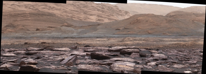 The foreground of this scene from the Mast Camera (Mastcam) on NASA's Curiosity Mars rover shows purple-hued rocks near the rover's late-2016 location on lower Mount Sharp. The scene's middle distance includes higher layers that are future destinations for the mission. Variations in color of the rocks hint at the diversity of their composition on lower Mount Sharp. The purple tone of the foreground rocks has been seen in other rocks where Curiosity's Chemical and Mineralogy (CheMin) instrument has detected hematite. Winds and windblown sand in this part of Curiosity's traverse and in this season tend to keep rocks relatively free of dust, which otherwise can cloak rocks' color. The three frames combined into this mosaic were acquired by the Mastcam's right-eye camera on Nov. 10, 2016, during the 1,516th Martian day, or sol, of Curiosity's work on Mars. The scene is presented with a color adjustment that approximates white balancing, to resemble how the rocks and sand would appear under daytime lighting conditions on Earth. Sunlight on Mars is tinged by the dusty atmosphere and this adjustment helps geologists recognize color patterns they are familiar with on Earth. The view spans about 15 compass degrees, with the left edge toward southeast. The rover's planned direction of travel from its location when this scene was recorded is generally southeastward. The orange-looking rocks just above the purplish foreground ones are in the upper portion of the Murray formation, which is the basal section of Mount Sharp, extending up to a ridge-forming layer called the Hematite Unit. Beyond that is the Clay Unit, which is relatively flat and hard to see from this viewpoint. The next rounded hills are the Sulfate Unit, Curiosity's highest planned destination. The most distant slopes in the scene are higher levels of Mount Sharp, beyond where Curiosity will drive. Figure 1 is a version of the same scene with annotations added as reference points for distance, size and relative e